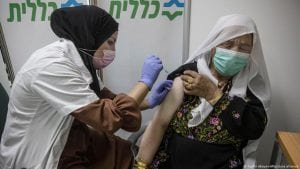 A woman receives the BioNTech-Pfizer COVID-19 vaccine in Beersheba