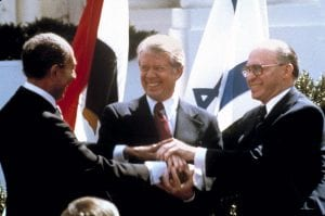 Anwar Sadat, Jimmy Carter, and Menachem Begin clasp hands at the White House as they sign the peace treaty between Egypt & Israel (AP/Bob Daugherty)